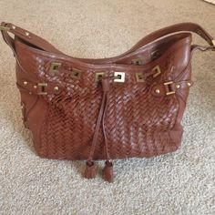 Cole Hann Brown Village Weave Purse Beautiful Brown and Gold Leather Cole Hann Purse .. It's a large size size suitable for carrying lots of stuff. Some love wear but lots of life left :) Cole Haan Bags