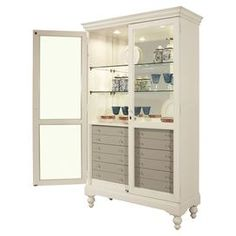 """Curio cabinet in white with a mirrored glass back and turned legs.  Product: CabinetConstruction Material: Wood and mirrored glassColor: WhiteDimensions: 77"""" H x 46.5"""" W x 18.5"""" D"""