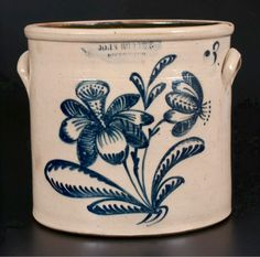 "Crocker Farm 7/19/14 Lot #183.   Sold: $1,725.  3 Gal. Crock with Floral Decoration, Stamped ""JOHN BURGER / ROCHESTER,"" NY State, ca. 1860. Cylindrical crock with tooled shoulder, semi-rounded rim, & applied lug handles. Flowering plant with alternating shaded & hollow petals, trumpet-shaped center to left blossom & nicely-detailed leaves. Excellent condition with a 2 3/4"" surface line from rim on front, not visible on interior. Minor glazed-over iron ping at base on reverse."