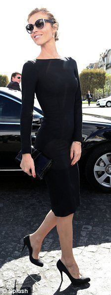 Upping the ante: Eva Herzigova and Olivia Palermo looked chic in all-black outfits for the show