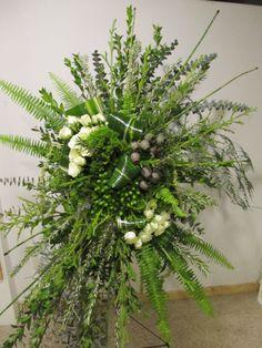 Funeral spray of equisetum, aspidistra leaves, sword fern, Eskimo spray roses, ming fern, myrtle, and lycopodium