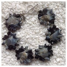 Handmade bracelet with lampwork by Clare Scott, swarovski-crystals and Sterling silver.   By torill-k