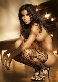 Topless Brunette Crouching Wearing Fishnets