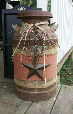 Recycled old milk can. From Country Cupboard on Facebook.