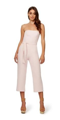 The Oyster Jumpsuit is a classic strapless jumpsuit that featureswide pant legs and a self tie at the waist. The Oyster Jumpsuit has a mock welt pocket at the