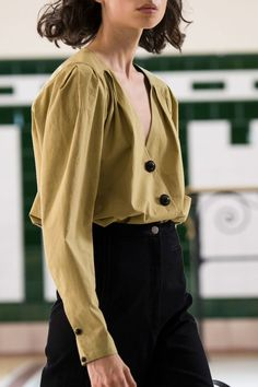 Lemaire Spring 2017. Gorgeous mustardy yellow blouse with v-neck and black buttons
