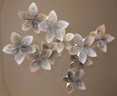 Musically Gifted Flower Mobile Upcycled....This is so sweet. I love this I idea for Andrea and Corey Garcia's baby someday in the future... If you ever want one let me know ;)