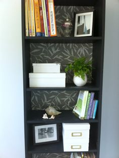 Take off the back panel and glue or mod podge fabric to bookshelf