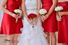 Alternating bouquet and dress colors with your bridesmaids helps tie together your wedding theme #wedding #roses #red