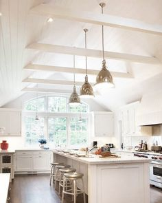 Kitchen Cathedral Ceiling Ideas Classic White Kitchen W Cathedral Ceiling Kitchen Vaulted Ceiling Lighting Ideas Vaulted Ceiling Kitchen, Vaulted Ceiling Lighting, Vaulted Ceilings, Basement Ceilings, Kitchen With Vaulted Ceiling, Kitchen Ceiling Design, White Ceiling, Vaulted Ceiling Bedroom, Raked Ceiling