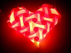 Heart Jigsaw/IQ/Puzzle Lamp - Pink color, the Lampshade is on the floor so can see the Reflection the light, can make this lampshade in many colors combinations and sizes. You will find instructions of how to assemble this Jigsaw Lamp at our blog.
