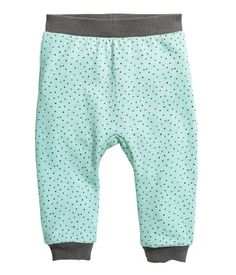 Mint green/dotted. CONSCIOUS. Joggers in soft, organic cotton sweatshirt fabric. Elasticized waistband and ribbed hems. Soft, brushed inside.