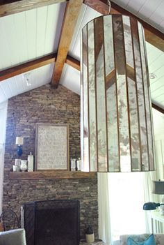 LOVE the exposed beams & mirrored light | Young House Love