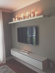 I like the candle shelf.for our bedroom, candle shelf over bed? Tv Wall Decor, Tv Area Decor, Candle Wall Decor, Wall Decorations, Apartment Living, Cozy Apartment, Apartment Ideas, Apartment Therapy, Apartment Design