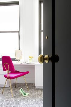 A black door opens to a chic bedroom filled with a white desk paired with a hot pink velvet chair, Jonathan Adler Maxime Chair, tucked under black framed windows. Farmhouse Office Chairs, Diy Beauty Room, Pink Accent Chair, White Bedroom Chair, Rocking Chair Makeover, Pink Velvet Chair, Black White Bedrooms, Green Armchair, Armchairs For Sale
