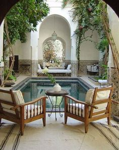 A serene Moroccan courtyard with a beautifully tiled pool. #Moroccan #Courtyard #Pool.