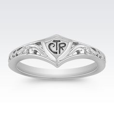 This darling Choose The Right ring is a Shane Co. exclusive designed and manufactured in our own facility.  The ring is crafted from quality sterling silver with an intricate cut-out design.  The addition of two round diamonds, at approximately .02 carat total gem weight, adds sparkle to the design. This ring was designed and manufactured in our own facility.