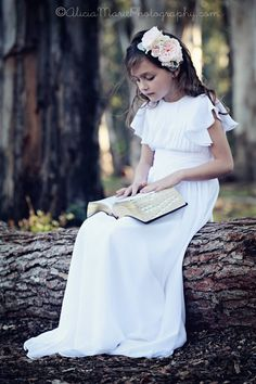 I am so in love with this baptism dress. It is the perfect LDS baptismal photo!