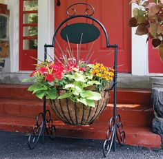 "Kinsman Garden Welcome Planter - Sturdy wrought iron frame, with ornamental scrolled legs and a generous 17"" basket including coco liner. The Oval Plate is blank, to be personalized with a name or house number, using letters and numbers available from most hardware stores."