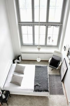 COCOCOZY shared this bedroom photo, obviously taken from a loft perspective--- I'd need some remote control blinds for these windows... Great light, though!!