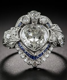 An Edwardian Heart-Shaped Diamond and Sapphire Ring. This is the first heart-shaped piece of jewelry I've EVERY found beautiful.