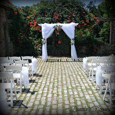 Ceremony Decorations by Pamela's Flowers - See more designs at http://pamelasflowers.wix.com/weddingsbypamela #weddingflowers #harrisburgflorist #ceremony #weddingceremony #ceremonyflowers #weddingdecorations