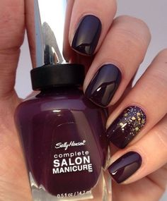 dark red nails with an accent one with gold sequins