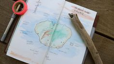 Midori Travelers Notebook.  Draw a map rather than glue it.