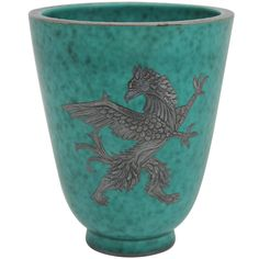 Gustavsberg Argenta griffin vase  Sweden  Circa 1930  Gustavsberg was founded outside Stockholm, Sweden in 1786. The firm had success in the nineteenth century making china in the style of English creamware. Wilhelm Kåge, an artist and potter who studied under Henri Matisse, joined the company in 1917 designing stoneware and porcelain one-off pieces.