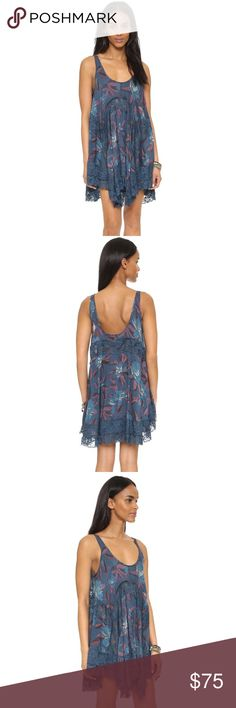 free people she swings dress NWT size medium This is a fun and flirty free people she swings dress. NWT size medium. Color is called blue combo but it is a beautiful bright blue with a fun floral pattern! Beautiful lace detail! Free People Dresses
