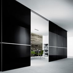 Graphis from Rimadesio is a system of sliding panels designed to divide spaces and is characterised by an extremely rigorous design. A structural profile in aluminum of minimal thickness holds double glass with soundproofing capacity. The panels are always made to measure in both height and width