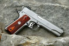 """Ahhh.. the Ruger SR1911 pistol. A tribute to the 1911, re-created and mastered for the first time by Sturm-Ruger. It is truly a fully-functioning work of art.  But, as Pennie will remind you, """"It ain't no Kimber!"""""""