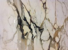 Paonazzo Marble? A rare type of Calacata Marble with colored viens. From the Carrara Quarries in Italy.