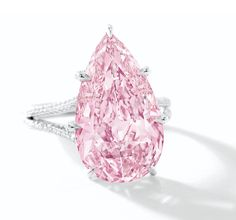Superb Fancy Vivid Pink Diamond and Diamond Ring; centering on a pear-shaped fancy vivid pink diamond to a stylized mount pavé-set throughout with circular-cut diamonds, mounted in platinum, signed Sotheby's Diamonds. Pink Diamond Ring, Pink Diamond Engagement Ring, Diamond Party, Pear Diamond, Pink Sapphire, Schmuck Design, Ring Verlobung, Diamond Are A Girls Best Friend, Colored Diamonds