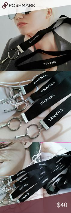 """CHANEL Ribbon Lanyards Authentic Chanel Ribbon made into lanyards using silver tone clamps and silver tone hardware. Lanyards hang 30"""" long. $15 each Accessories Key & Card Holders"""