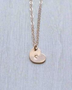 Tiny Stamped Initial Heart Necklace in silver, gold or rose gold. Have a letter added or leave it blank. Perfect for layering. By Olive Yew.