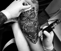 A wise and lonely owl in a half sleeve tattoo design for a man