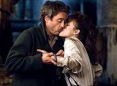 "Robert Downey Jr. as Holmes and Rachel McAdams as Irene in ""Sherlock Holmes"" (2009)"