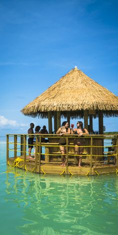 Floating Bar, Bahamas | There's no need to towel off to enjoy this latest CocoCay attraction. Just swim up, order a drink and enjoy.