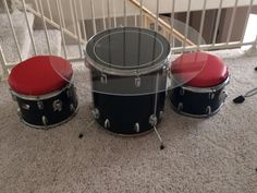 Drum table and chairs! Plexiglass top screwed onto drum using existing drum hardware but longer screws. Round wood covered in foam and leather like fabric for seats. Drum legs allow drum table to be adjusted for height. Don't use a bass drum for middle of table. Use a smaller drum so kids feet have room to go under.