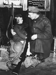 British soldier has a last minute chat with his young daughter at a London railway station before returning to France from his Christmas leave. 1940