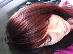 Dark brunette and red highlights. its pretty much what i want color wise