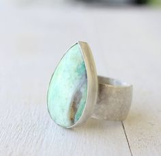 like the ocean...a little big for my taste...but I LOVE the stone and the silver setting.