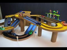 DIY Magic track with magic cars out of cardboard Cardboard Crafts Kids, Fun Crafts For Kids, Toilet Paper Roll Crafts, Diy For Kids, Cardboard Race Track, Cardboard Car, Kids Car Garage, Diy Toys Car, Make Your Own Game