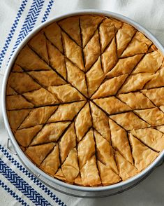 Walnut-and-Honey Baklava | Martha Stewart - The many buttered layers of phyllo dough, walnut filling, and sweet syrup make baklava the ultimate special-occasion dessert in Greece. #baklava #honeyrecipe #phyllodough #walnutrecipe #dessertfoodrecipes