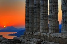 nerd-gasms: theunauthorizedhistory:duffel: Sunset at Temple of Poseidon, which is located two hours south of Athens, Greece at Cape Sunion. Photo by Bobesh. Thessaloniki, Parthenon Athens, Albania, Beautiful Sunset, Beautiful Places, Places To Travel, Places To See, Places Around The World, Sunsets