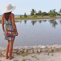 Woman overlooking a lake wearing a colourful leather bag. Lake Wear, Front Design, Leather Crossbody Bag, Tan Leather, Cross Body, Compliments, Woman, Fabric, How To Wear