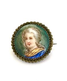 Wonderful Victorian Hand Painted Portrait Brooch  What a lovely miniature portrait of a beautiful Renaissance women. She is dressed in a blue with a golden collar or shawl. Handpaintd enamel is in wonderful antique condition. The amazing little portrait is framed in a pretty understated gold plated brass mount.  Measures: Approx. 1  Mark: None  Condition: Very Good vintage/antique condition   Please do keep in mind that any vintage and/or antique merchandise may have some degree of ...