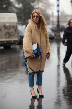Smoking is harmful to your fur.  Paris Street Style Fall 2013 - Paris Fashion Week Style Fall 2013 - Harper's BAZAAR
