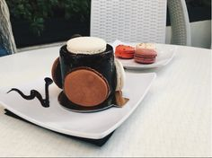 Trilogie surrounded by macarons!
